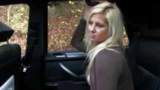 Natural blonde valentine is undressing herself in the car