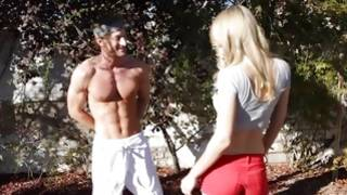 Blonde naughty gf is posing with muscular dude