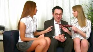 Threesome where both young harlots are pleasuring a massive lollipop